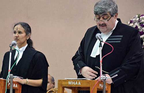 Justice Anita Sumanth being administered oath by Chief Justice Sanjay Kishan Kaul